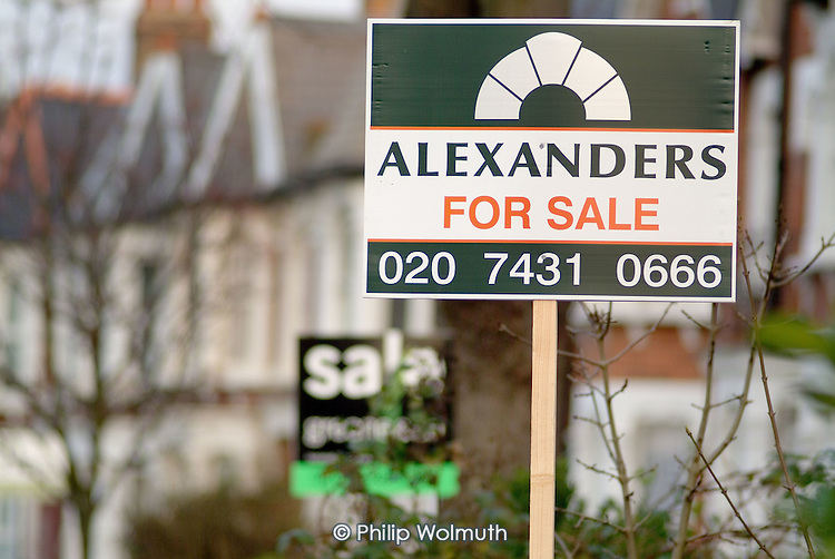 Estate agent's board outside a house in West Hampstead, London.