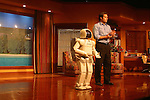 "ASIMO, an acronym for Advanced Step in Innovative Mobility,[1] is a humanoid robot designed and developed by Honda. Introduced on 21 October 2000, ASIMO was designed to be a multi-functional mobile assistant.[2] With aspirations of helping those who lack full mobility, ASIMO is frequently used in demonstrations across the world to encourage the study of science and mathematics.[3] At 130 cm (4 ft 3 in) tall and 48 kg (106 lb), ASIMO was designed to operate in real-world environments, with the ability to walk or run on two feet at speeds of up to 6 kilometres per hour (3.7 mph).[2] In the USA, ASIMO is part of the Innoventions attraction at Disneyland and has been featured in a 15-minute show called ""Say 'Hello' to Honda's ASIMO"" since June 2005."