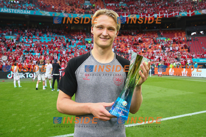 """AMSTERDAM, NETHERLANDS - JUNE 26: Kasper Dolberg of Denmark poses for a photograph with their Heineken """"Star of the Match"""" award after the UEFA Euro 2020 Championship Round of 16 match between Wales and Denmark at Johan Cruijff Arena on June 26, 2021 in Amsterdam, Netherlands. (Photo by Christopher Lee - UEFA/UEFA via Getty Images)<br /> Photo Uefa/Insidefoto ITA ONLY"""
