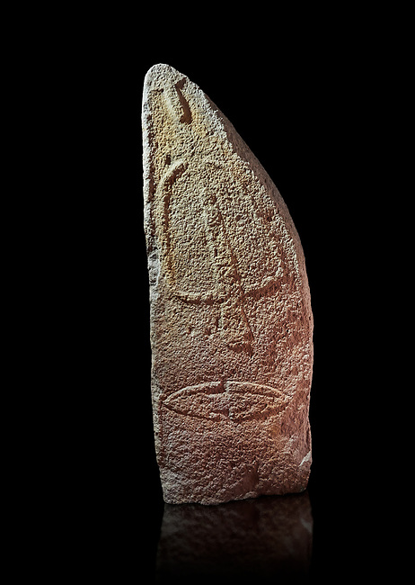 Late European Neolithic prehistoric Menhir standing stone with carvings on its face side. The representation of a stylalised male figure starts at the top with a long nose from which 2 eyebrows arch around the top of the stone. below this is a carving of a falling figure with head at the bottom and 2 curved arms encircling a body above. at the bottom is a carving of a dagger running horizontally across the menhir. Excavated from Pranu Maore I site,  Laconi. Menhir Museum, Museo della Statuaria Prehistorica in Sardegna, Museum of Prehoistoric Sardinian Statues, Palazzo Aymerich, Laconi, Sardinia, Italy. Black background.