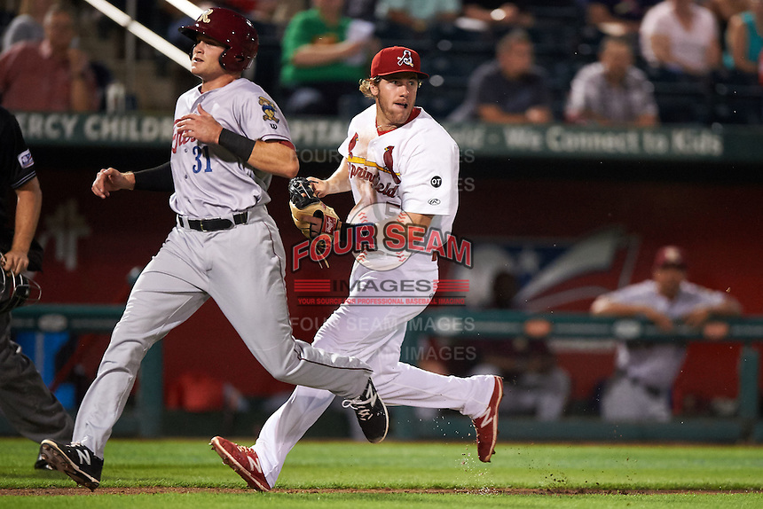 Springfield Cardinals third baseman Patrick Wisdom (5) tags Preston Beck (31) during a game against the Frisco RoughRiders  on June 4, 2015 at Hammons Field in Springfield, Missouri.  Frisco defeated Springfield 8-7.  (Mike Janes/Four Seam Images)