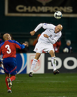 Conor Casey heads the ball during a 2-2 tie with Costa Rica to put the USA in first place of CONCACAF 2010 World Cup qualifying, at RFK Stadium, in Washington DC, Wednesday, October 14, 2009.