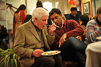After the wedding ceremony of British/Punjabi couple Lindsay and Navneet Singh, the bride's father receives dining advice from a guest at a reception in Amritsar.