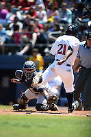 Mobile BayBears catcher Raywilly Gomez (15) attempting to tag D' Vontrey Richardson (21) scoring a run during a game against the Huntsville Stars on April 23, 2014 at Joe Davis Stadium in Huntsville, Tennessee.  Huntsville defeated Mobile 4-1.  (Mike Janes/Four Seam Images)