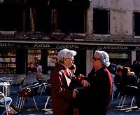 Venetian ladies exchange news in front of Bar Rosa Salva in the San Marco district of Venice.