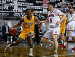 SIOUX FALLS, SD - MARCH 8: Tyree Eady #3 of the North Dakota State Bison looks for room past Kruz Perrott-Hunt #5 of the South Dakota Coyotes during the Summit League Basketball Tournament at the Sanford Pentagon in Sioux Falls, SD. (Photo by Dave Eggen/Inertia)