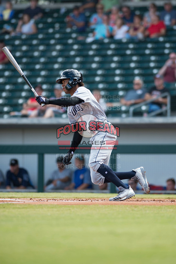Peoria Javelinas left fielder Buddy Reed (85), of the San Diego Padres organization, follows through on his swing during an Arizona Fall League game against the Mesa Solar Sox at Sloan Park on October 11, 2018 in Mesa, Arizona. Mesa defeated Peoria 10-9. (Zachary Lucy/Four Seam Images)