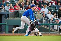 Midland RockHounds pitcher Brian Howard (23) tags Northwest Arkansas Naturals infielder D.J. Burt (1) in a run-down on May 4, 2019, at Arvest Ballpark in Springdale, Arkansas. (Jason Ivester/Four Seam Images)