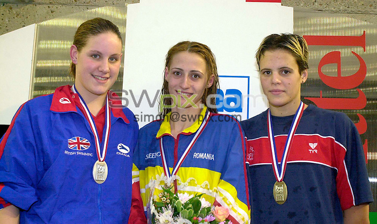Pix:Ben Duffy/SWpix.com. FINA World Cup Swimming-Paris, Piscine George Vallerey....18/01/2003...COPYRIGHT PICTURE>>SIMONWILKINSON>>01943 436649>>..Great Britains Joanne Jackson steps up to receive her Silver medal for the womens 400m Freestyle