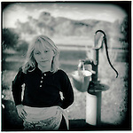 AUGUST 1995    -  Alice Springs, Australia   -  A young girl poses in front of a water well at the Old Telegraph station in the Outback of Alice Springs, Australia. .