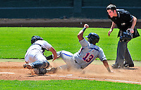 15 July 2010: Aberdeen IronBirds' infielder Omar Casamayor is tagged out at home during action against the Vermont Lake Monsters at Centennial Field in Burlington, Vermont. The Lake Monsters rallied in the bottom of the 9th inning to defeat the IronBirds 7-6 notching their league leading 20th win of the 2010 NY Penn League season. Mandatory Credit: Ed Wolfstein Photo