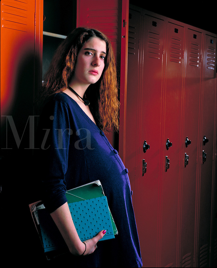 Pregnant teen posing by her high school locker. Billboard and broadcast must be negotiated, due to talent agreement. United States.