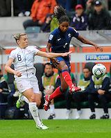 Amy Rodriguez (l) of team USA and Laura Georges of team France during the FIFA Women's World Cup at the FIFA Stadium in Moenchengladbach, Germany on July 13th, 2011.