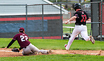 SOUTHBURY, CT 050721JS10—Pomperaug's Seth O'Rourke (22) is called out at first after Bethel's Daniel Rodriguez (22) slides to the bag first while covering the play during their game  Friday at Pomperaug High School. <br /> Jim Shannon Republican American