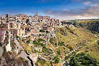 "Vew of ""la Gravina"" ravine and the Sassi of Matera, Basilicata, Italy. A UNESCO World Heritage site.<br /> <br /> The area of Matera has been occupied since the Palaeolithic (10th millennium BC) making it one of the oldest continually inhabited settlements in the world. <br /> The town of Matera was founded by the Roman Lucius Caecilius Metellus in 251 BC and remained a Roman town until  was conquered by the Lombards In AD 664 becoming part of the Duchy of Benevento.  Matera was subject to the power struggles of southern Italy coming under the rule of the Byzantine Roman, the Germans and finally Matera was ruled by the Normans from 1043 until the Aragonese took possession in the 15th century. <br /> <br /> At the ancient heart of Matera are cave dwellings known as Sassi. As the fortunes of Matera failed the sassy became slum dwelling and the appalling living conditions became be the disgrace of Italy. From the 1970's families were forcibly removed from the Sassi and rehoused in the new town of Matera. Today tourism has regenerated Matera and the sassi have been modernised and are lived in again making them probably the longest inhabited houses in the world dating back 9000 years."