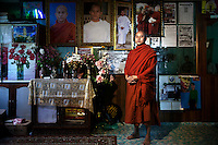 U Wirathu, the controversial Buddhist nationalists monk and spiritual leader of the 969 Movement, poses for a portrait in front of pictures of himself in his quarters at the New Maesoeyin Monastery in Mandalay. U Wirathu is an abbot in the New Maesoeyin Monastery where he leads about 60 monks and has influence over more than 2,500 residing there. /Felix Features