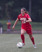 Boston University midfielder Jessica Luscinski (12) brings the ball forward. After 2 complete overtime periods, Boston College tied Boston University, 1-1, after 2 overtime periods at Newton Soccer Field, August 19, 2011.