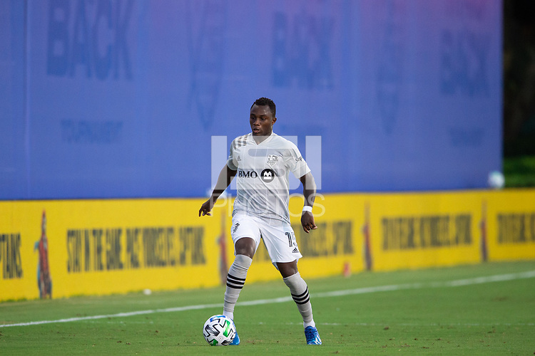 LAKE BUENA VISTA, FL - JULY 25: Zachary Brault-Guillard #15 of the Montreal Impact dribbles the ball during a game between Montreal Impact and Orlando City SC at ESPN Wide World of Sports on July 25, 2020 in Lake Buena Vista, Florida.