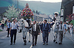 Castleton Garland Day Castleton Derbyshire UK May 29th. Oak Apple Day King and Queen on horseback walk around the village of Castleton. 1980s.