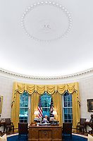President Joe Biden looks over notes at the Resolute Desk, Wednesday, June 30, 2021, in the Oval Office of the White House. (Official White House Photo by Adam Schultz)