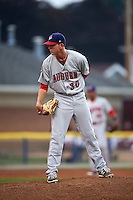 Auburn Doubledays pitcher Taylor Guilbeau (30) looks in for the sign during a game against the Batavia Muckdogs on September 5, 2015 at Dwyer Stadium in Batavia, New York.  Batavia defeated Auburn 6-3.  (Mike Janes/Four Seam Images)