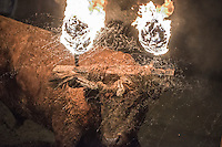 """The bull is seen after the reveler set a on fire during the festivity called toro de jubilo in Medinaceli, near Soria, on november 14, 2015. """"El toro de jubilo"""" is a festival that takes place in Medinaceli. Every year, on the second weekend of November,  the bull is surrounded and restrained by participants. During this festival, a bull is tied to a post. Balls are then placed on each horn of the bull and lit a flame. A think layer of mud on the back and face of the bull helps protect the bull from physical injury or burns. The bull is then released by the square, which has 5 fire lit bonfires symbolizing five martyrs.   © PEDRO ARMESTRE"""