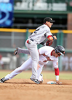 Shortstop Jose Iglesias is upended on a forceout by Bryce Harper of the Scottsdale Scorpions, who defeated the Peoria Javelinas, 3-2, to win the Arizona Fall League championship at Scottsdale Stadium, Scottsdale, AZ - 11/20/2010.Photo by:  Bill Mitchell/Four Seam Images..