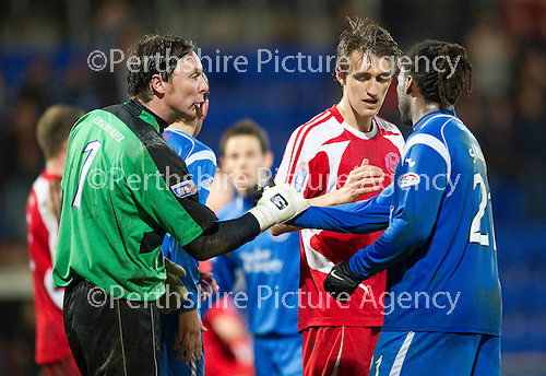 St Johnstone v Brechin....22.03.11  Scottish Cup Quarter Final replay.Ex-saintee Craig Nelson shakes hands with Collin Samuel at full time.Picture by Graeme Hart..Copyright Perthshire Picture Agency.Tel: 01738 623350  Mobile: 07990 594431