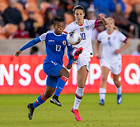HOUSTON, TX - JANUARY 28: Emeline Charles #13 of Haiti fights for the ball with Carli Lloyd #10 of the United States during a game between Haiti and USWNT at BBVA Stadium on January 28, 2020 in Houston, Texas.