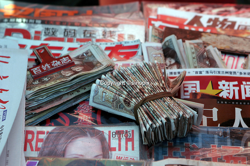 Bundles of Chinese RMB spare changes are pictured in a news stand in Beijing, China..