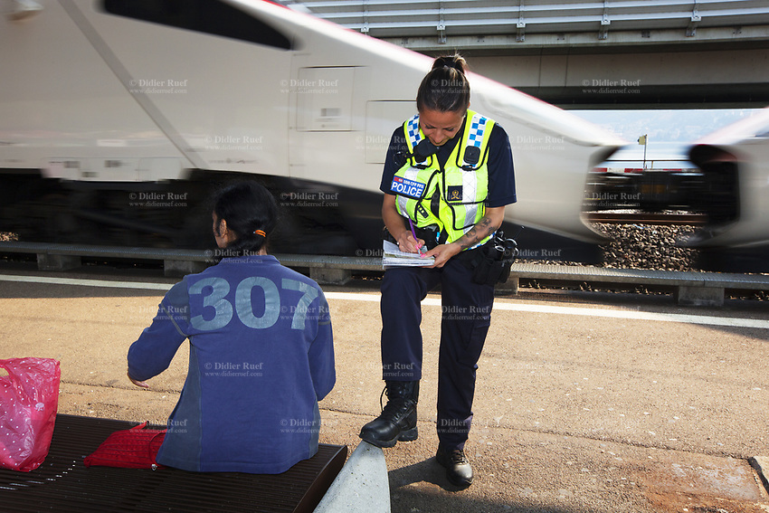 Switzerland. Canton Ticino. Melide. A police officer from TPO (Transport Police) writes a fine to a Romanian Romani woman who was travelling without valid ticket in a TILO train. An Intercity train ( Alstom ETR 610) is passing at high speed on the tracks. The Romani (also spelled Romany, Roma, Roms or Rroms, are a traditionally nomadic ethnic group. TPO (Transport Police) is the Swiss Federal Railways Police. Swiss Federal Railways (German: Schweizerische Bundesbahnen (SBB), French: Chemins de fer fédéraux suisses (CFF), Italian: Ferrovie federali svizzere (FFS)) is the national railway company of Switzerland. It is usually referred to by the initials of its German, French and Italian names, as SBB CFF FFS. TILO (Treni Regionali Ticino Lombardia) creates efficient train connections between the towns in the canton Ticino. 12.06.2017 © 2017 Didier Ruef
