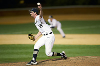 Wake Forest Demon Deacons relief pitcher Carter Bach (18) in action against the Sacred Heart Pioneers at David F. Couch Ballpark on February 15, 2019 in  Winston-Salem, North Carolina.  The Demon Deacons defeated the Pioneers 14-1. (Brian Westerholt/Four Seam Images)