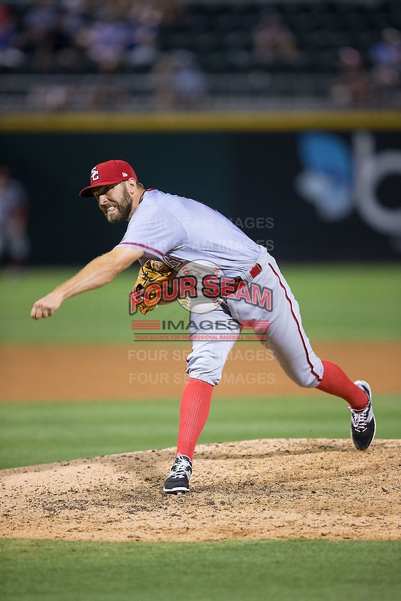 Syracuse Chiefs relief pitcher Matt Grace (21) follows through on his delivery against the Charlotte Knights at BB&T BallPark on June 1, 2016 in Charlotte, North Carolina.  The Knights defeated the Chiefs 5-3.  (Brian Westerholt/Four Seam Images)