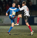 Shire's Ross Gilmour and Montrose's Jonathan Crawford challenge for the high ball.