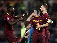 Calcio, Serie A: Roma, stadio Olimpico, 19 marzo, 2017<br /> Roma's Edin Dzeko (r) celebrates with his teammates Radja Nainggolan (c) and Antonio Rudiger (l) after scoring during the Italian Serie A football match between Roma and Sassuolo at Rome's Olympic stadium, March 19, 2017<br /> UPDATE IMAGES PRESS/Isabella Bonotto