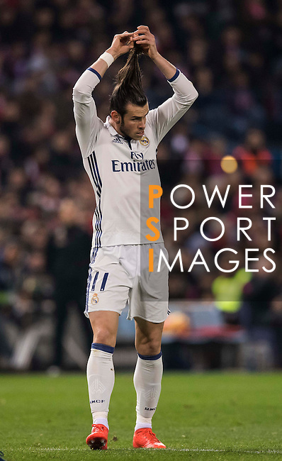 Gareth Bale of Real Madrid combs his hair during their La Liga match between Atletico de Madrid and Real Madrid at the Vicente Calderón Stadium on 19 November 2016 in Madrid, Spain. Photo by Diego Gonzalez Souto / Power Sport Images