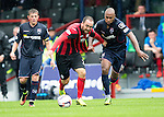 Ross County v St Johnstone...10.08.14  SPFL<br /> Lee Croft is fouled by Yoann Arquin<br /> Picture by Graeme Hart.<br /> Copyright Perthshire Picture Agency<br /> Tel: 01738 623350  Mobile: 07990 594431