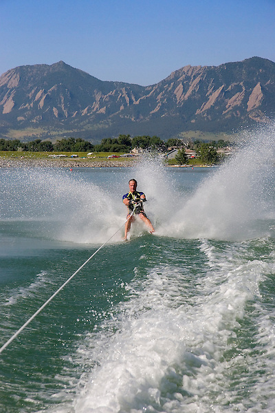 Senior citizen barefoot waterskiing, Boulder Reservoir, Colorado, John offers private photo tours of Boulder, Denver and Rocky Mountain National Park. .  John offers private photo tours in Denver, Boulder and throughout Colorado. Year-round.