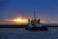 The sun is seen rising from the entrance to Swansea Docks in south Wales, UK. Tuesday 19 February 2019