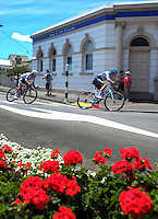 Riders race through Martinborough Square during stage three of the NZ Cycle Classic UCI Oceania Tour in Wairarapa, New Zealand on Tuesday, 24 January 2017. Photo: Dave Lintott / lintottphoto.co.nz