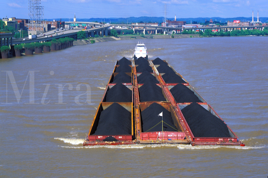 tugboat pushing coal barges up Ohio River Louisville Kentucky