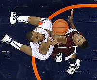 CHARLOTTESVILLE, VA- December 27: Darion Atkins #32 of the Virginia Cavaliers shoots over Percy Woods #12 of the Maryland-Eastern Shore Hawks during the game on December 27, 2011 at the John Paul Jones Arena in Charlottesville, Va. Virginia defeated Maryland Eastern Shore 69-42.  (Photo by Andrew Shurtleff/Getty Images) *** Local Caption *** Percy Woods;Darion Atkins