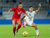 ORLANDO, FL - FEBRUARY 21: Jordyn Listro #21 of Canada fights for the ball with Lorena Benitez #16 of Argentina during a game between Canada and Argentina at Exploria Stadium on February 21, 2021 in Orlando, Florida.