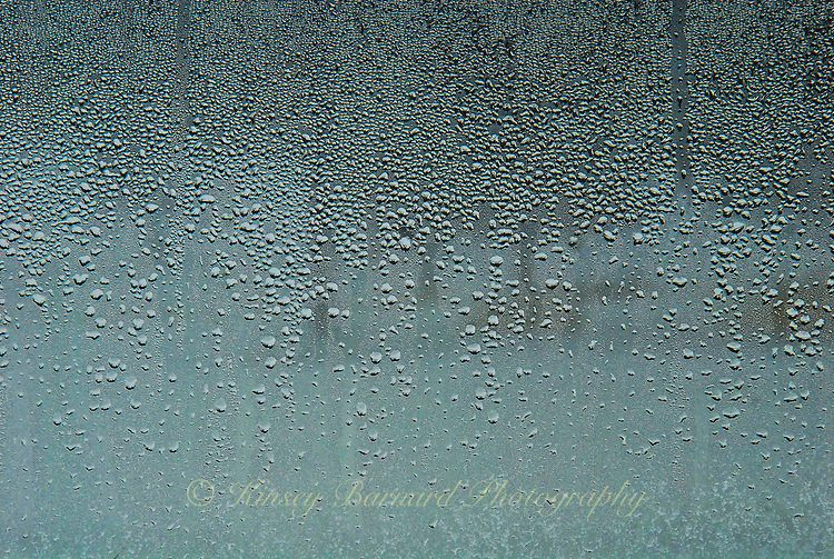 """""""WATER DROP LANDSCAPE""""<br /> <br /> Water drops on window panes with a winter landscape barely visible beyond."""