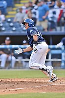 Asheville Tourists designated hitter Colton Welker (24) runs to first base during a game against the Greenville Drive at McCormick Field on April 15, 2017 in Asheville, North Carolina. The Tourists defeated the Drive 5-4. (Tony Farlow/Four Seam Images)