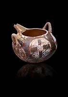 Minoan Kamares Ware with polychrome decorations on a rough prickly surface, Phaistos 1900-1700 BC;Heraklion Archaeological  Museum, black background.<br /> <br /> This style of pottery is named afetr Kamares cave where this style of pottery was first found
