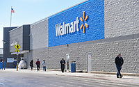 Shoppers walk, Thursday, February 18, 2021 along the sidewalk of the Walmart Supercenter in Bentonvile. Check out nwaonline.com/210219Daily/ for today's photo gallery. <br /> (NWA Democrat-Gazette/Charlie Kaijo)