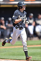 Vanderbilt Commodores center fielder Bryan Reynolds (20) runs to first during a game against the Tennessee Volunteers at Lindsey Nelson Stadium on April 24, 2016 in Knoxville, Tennessee. The Volunteers defeated the Commodores 5-3. (Tony Farlow/Four Seam Images)