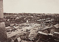 BNPS.co.uk (01202 558833)<br /> Pic: ForumAuctions/BNPS<br /> <br /> Pictured: Thomson captured bustling city scenes<br /> <br /> Rarely seen 150 year old photos taken by one of the first British photographers to explore China have emerged for sale for £20,000.<br /> <br /> Scotsman John Thomson (1837-1921) travelled to the Far East in 1868 and established a studio in Hong Kong, using it as a base to explore remote parts of the vast country for the next four years, photographing landmarks, scenery and the native population.<br /> <br /> In many cases, he was the first Westerner the people he photographed had encountered.<br /> <br /> One striking image shows a prisoner in chains with a head poking through a board covered in Chinese symbols, perhaps listing his misdemeanours. In another, a man poses next to a giant camel statue in the grounds around the Ming tombs of the Forbidden City.<br /> <br /> Almost 100 of his photos feature in a rare first edition of 'Thomson Illustrations of China and Its People' (1873), which is going under the hammer with London-based Forum Auctions.