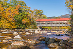 Fall foliage and the Albany Covered Bridge  in the White Mountain National Forest, New Hampshire, USA